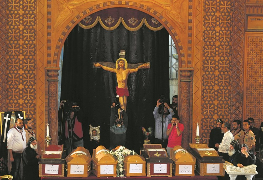 Copts count their dead after another murderous attack